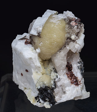 Bavenite with Microcline, Clinochlore and Spessartine.