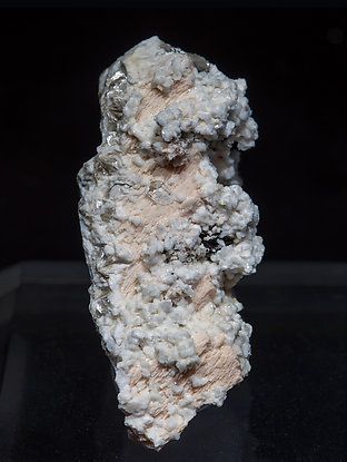 Stokesite with Microcline, Albite and Muscovite.