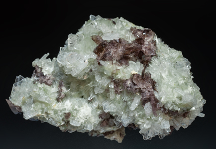 Axinite-(Fe) on Albite and Actinolite (variety byssolite).