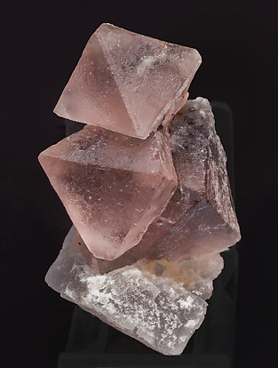 Octahedral Fluorite with inclusions and Calcite. Side
