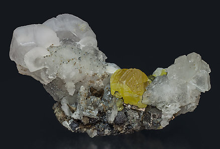 Sphalerite with Calcite, Quartz, Arsenopyrite and Sphalerite.