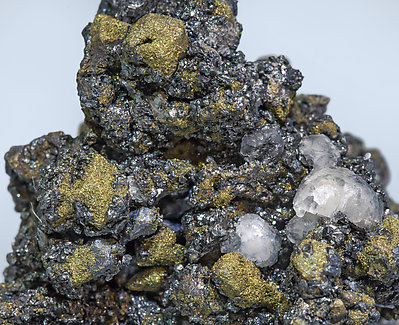 Selenium-rich Acanthite with Selenium-rich Polybasite and Calcite.