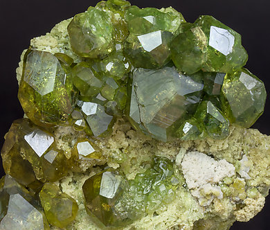Andradite (variety demantoid) with Calcite.