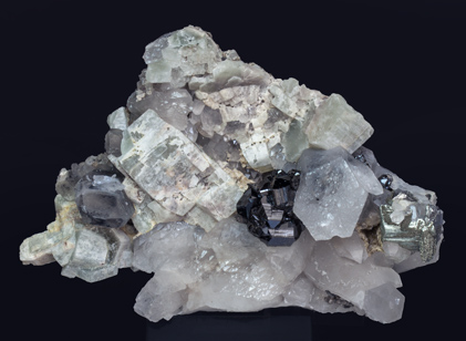 Cassiterite with Quartz, Fluorapatite and Arsenopyrite.