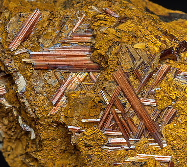 Rutile (variety sagenite) with Siderite and limonite.