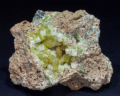 Fluorapatite with Calcite and Hematite.