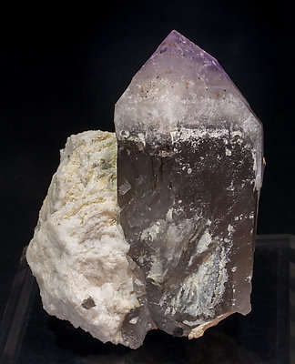 Quartz (variety amethyst) with Quartz (variety smoky) and Microcline. Front
