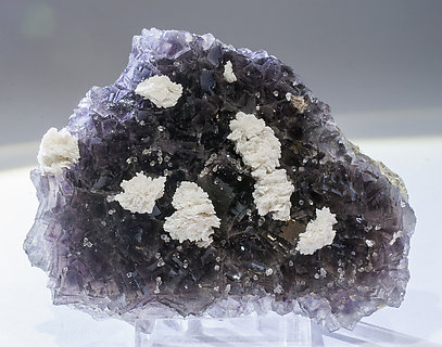 Fluorite with Dolomite and Quartz. Light behind