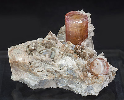 Elbaite (variety rubellite) with Quartz and Feldspar.