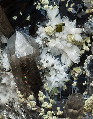 Bertrandite with Quartz (variety smoky) and Pyrite.