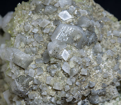 Fluorapophyllite-(K) with Harmotome and Calcite.