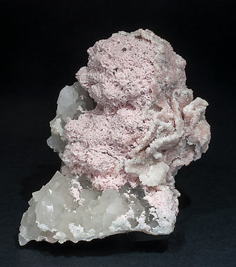 Rhodochrosite with Quartz and Rhodochrosite epitactic Quartz.