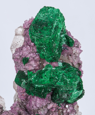 Malachite after Azurite on Calcite (variety cobaltoan) and Calcite.