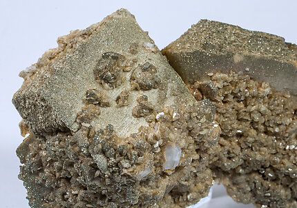 Siderite with Fluorapatite and Mica.