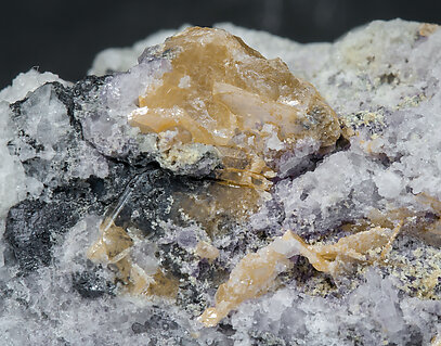 Wulfenite (variety chillagite) with Baryte, Fluorite, Cerussite and Galena.
