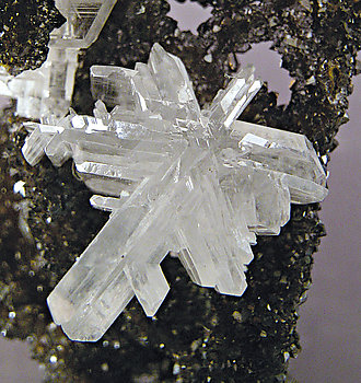 Cerussite on Quartz with Goethite inclusions.