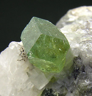 Andradite (variety demantoid chromium rich).