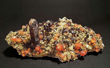 Spessartine with smoky Quartz and Clinochlore.