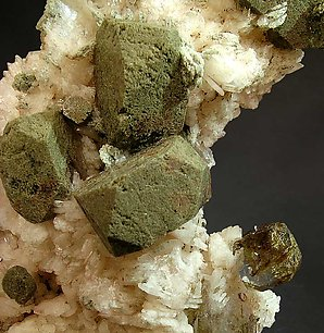 Fluorapophyllite-(K) with Stilbite and inclusions.