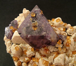 Octahedral Fluorite on Orthoclase and Spessartine.