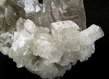 Ba-rich Microcline (variety hyalophane) on Quartz (variety smoky).