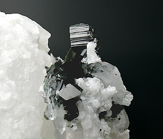 Babingtonite with Calcite and Quartz.