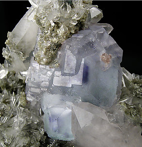 Octahedral Fluorite with Quartz, Ferberite and Muscovite.