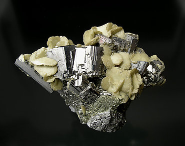 Arsenopyrite with Siderite and Chalcopyrite.