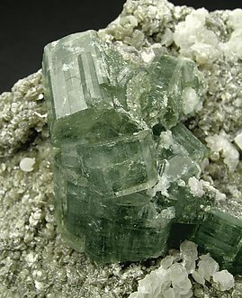 Fluorapatite with Calcite and Muscovite.