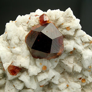 Spessartine with Feldspar and Mica.