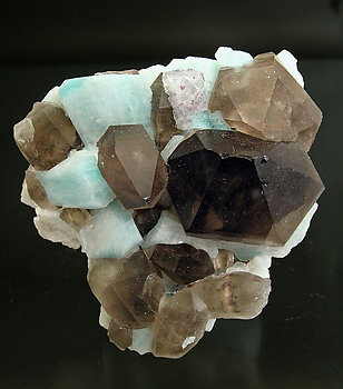 Quartz (variety smoky) with Microcline (variety amazonite) and Fluorite.