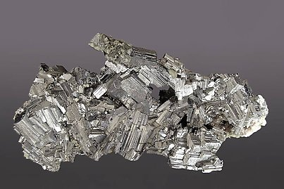 Arsenopyrite with Siderite and Pyrite.