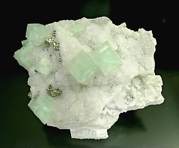 Fluorite with Quartz, Pyrite and Calcite.