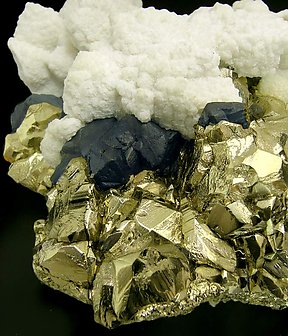 Pyrite and Chalcopyrite with Calcite.
