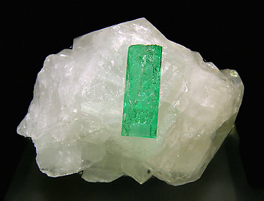 Doubly terminated Beryl (variety emerald) on Calcite.
