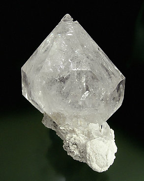 Doubly terminated Quartz with Calcite. Front