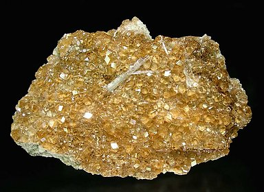 Grossular (variety hessonite) with Wollastonite.