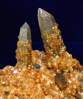 Spessartine with smoky Quartz.