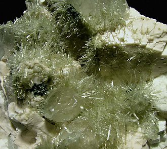 Clinozoisite-Epidote with Quartz and Orthoclase.