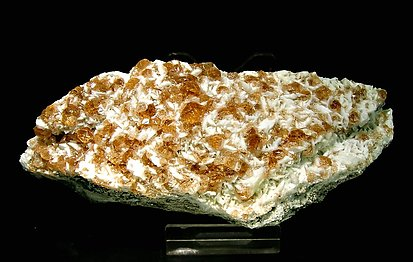 Grossular (variety hessonite) with Pectolite.