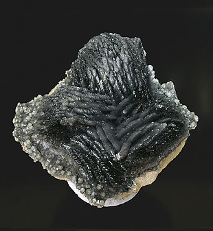 Calcite with Boulangerite inclusions. Rear