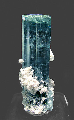 Elbaite (variety indicolite) with Lepidolite and Quartz.