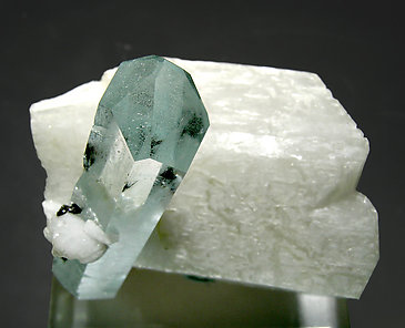 Beryl (variety aquamarine) with feldspar and Schorl. Top