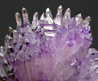 Quartz (variety amethyst) with Hematite inclusions.