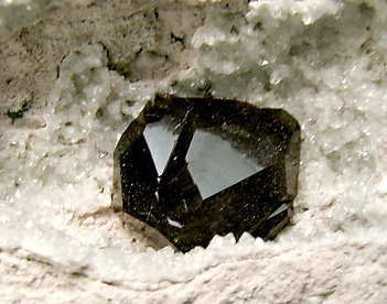 Almandine with Quartz.