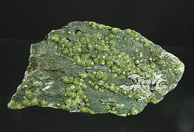Andradite (variety demantoid).