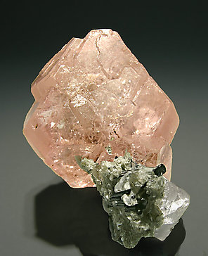 Fluorite with Muscovite and Schorl. Bulb light