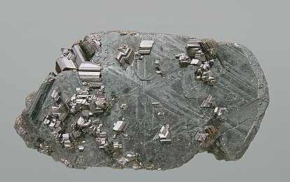 Rutile and Hematite pseudomorph after Ilmenite.