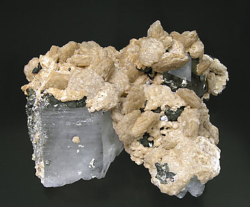 Siderite with Quartz and inclusions.