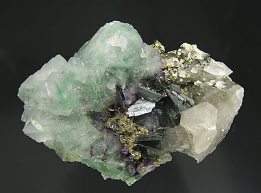 Octahedral Fluorite with Ferberite, Quartz and Pyrite.